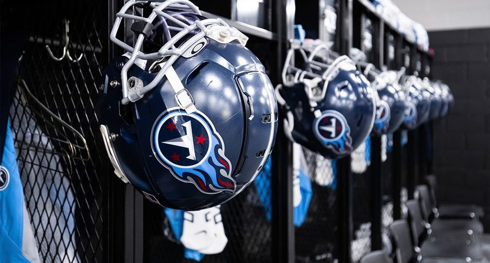 Tennessee Titans Lockers with helmets hanging on the door