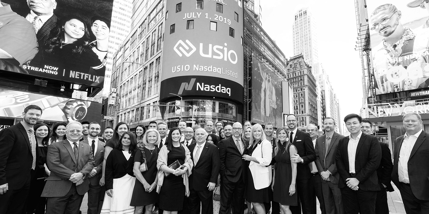 The Usio team standing in New York City for their Initial Public Offering