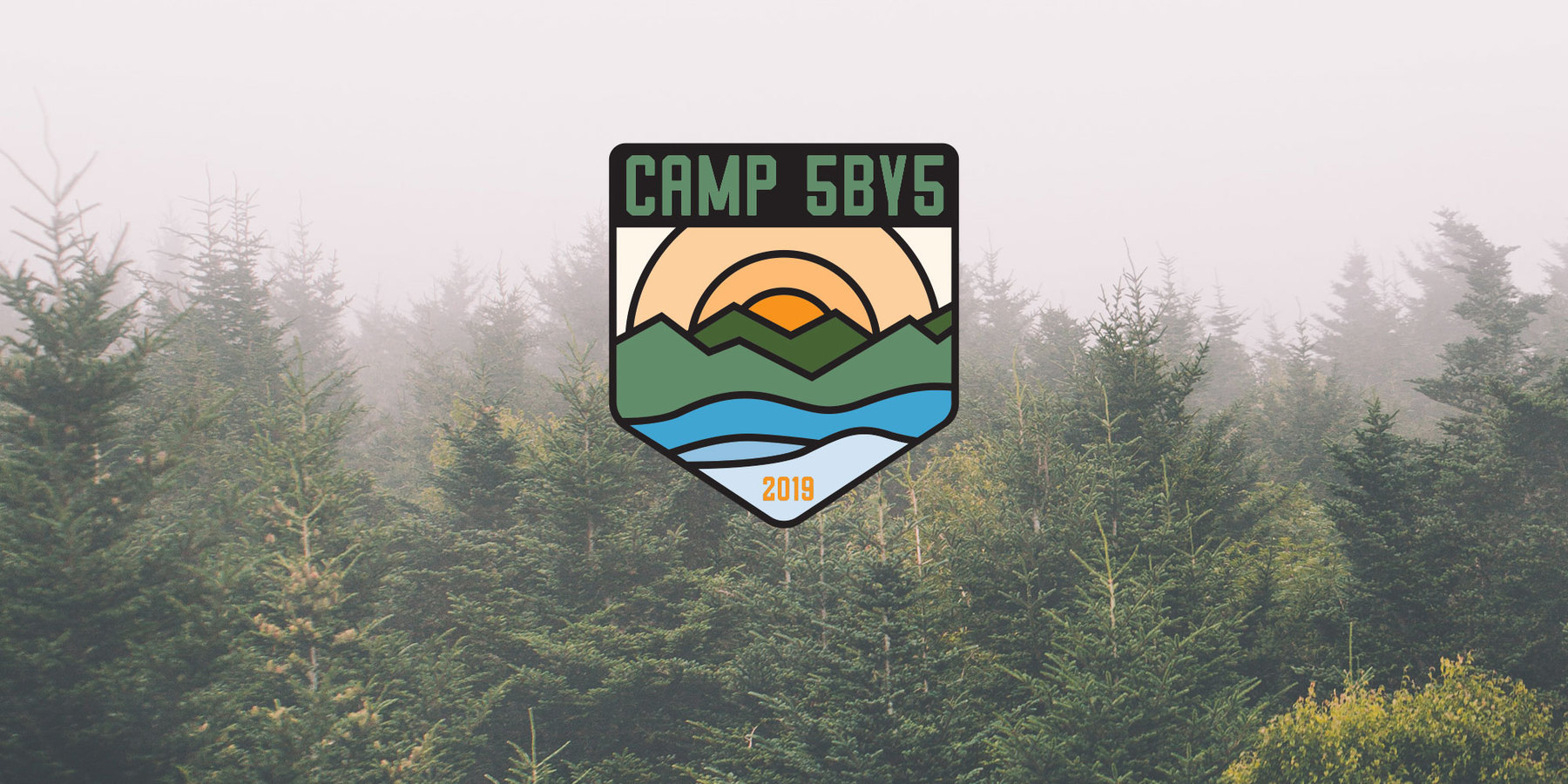 A forest of pine trees on a foggy day with the Camp 5by5 Logo as an overlay