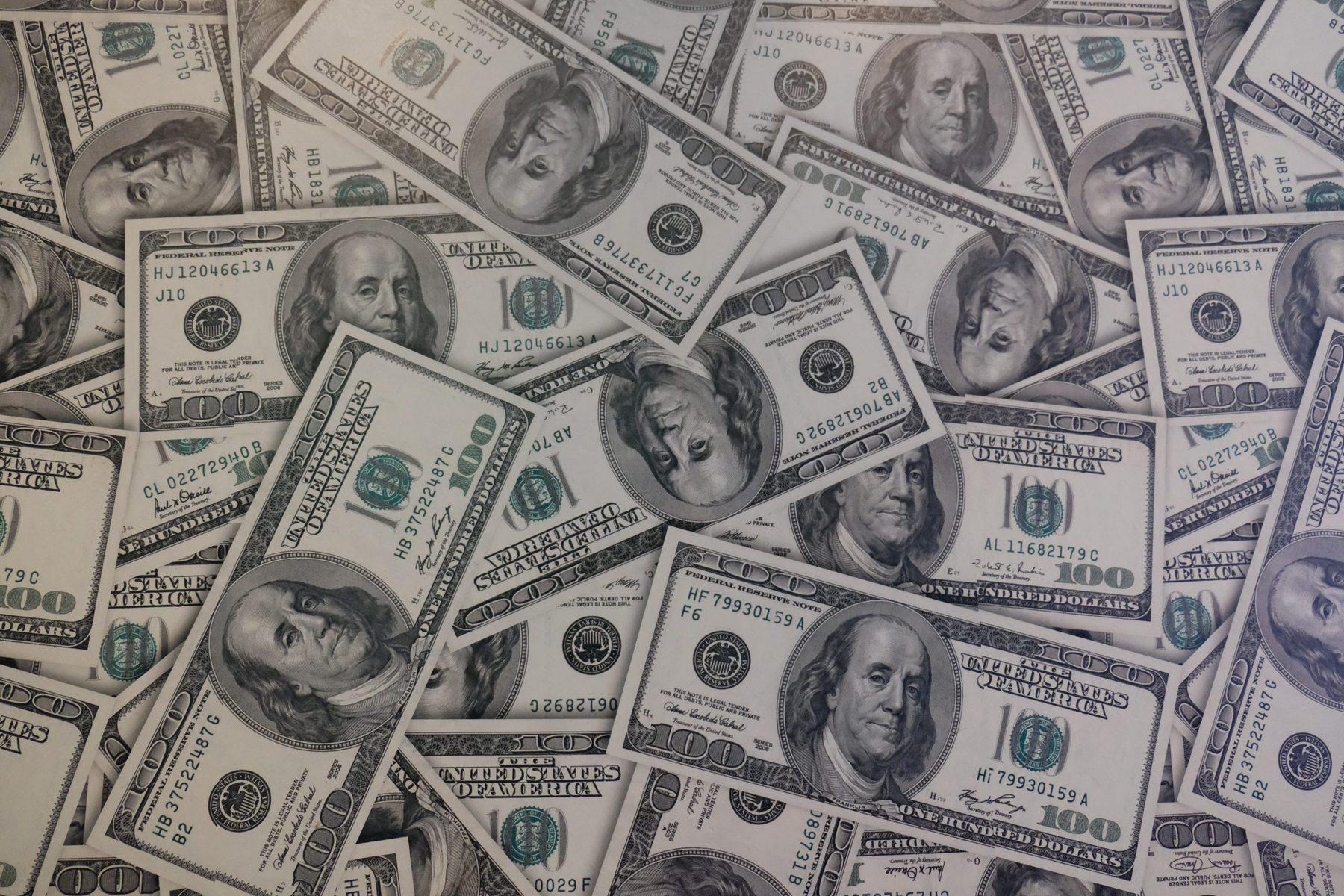 Piles of one hundred dollar bills